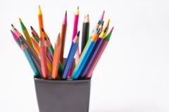 Lápis coloridos na caixa negra em um fundo branco De volta ao conceito da escola Imagens de Stock Royalty Free