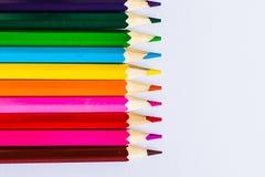 Lápis coloridos no fundo branco, deixado Foto de Stock Royalty Free
