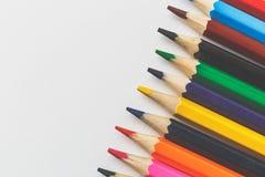Lápis coloridos no fundo do Livro Branco Imagem de Stock