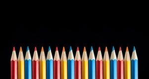 Lápis coloridos no fundo preto Imagens de Stock Royalty Free