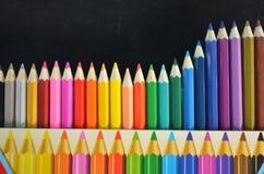 Lápis coloridos no fundo preto Fotografia de Stock Royalty Free