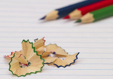 Lápis coloridos no papel Fotografia de Stock Royalty Free