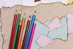 Lápis coloridos no papel Imagem de Stock Royalty Free