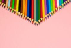 Lápis da cor com o espaço da cópia isolado no fundo cor-de-rosa fotos de stock