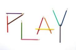 Lápis da cor como o JOGO da letra Fotografia de Stock