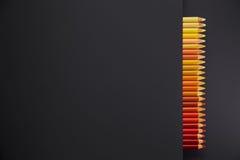 Lápis da cor em um fundo preto imagem de stock