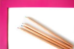 Lápis da cor no frame cor-de-rosa Fotos de Stock Royalty Free