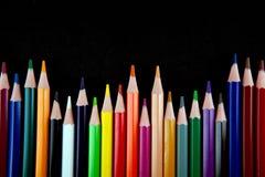 Lápis da cor no fundo preto Imagem de Stock Royalty Free