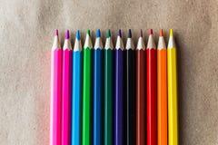 Lápis da cor no papel do artesanato Fotografia de Stock