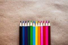 Lápis da cor no papel do ofício Fotos de Stock Royalty Free