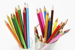 Lápis da cor nos vidros Fotografia de Stock