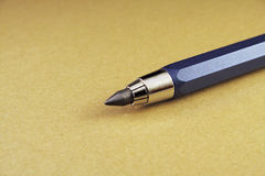 Lápis do metal no fundo marrom imagem de stock royalty free