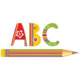 Lápis e alfabetos da cor Fotografia de Stock
