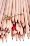Lápis e chave Imagens de Stock