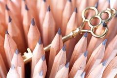 Lápis e chave Imagens de Stock Royalty Free