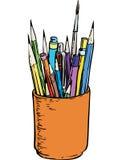 Lápis e escovas coloridos no suporte Fotografia de Stock Royalty Free