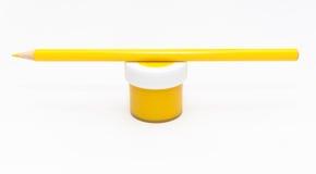 Lápis e gouache amarelos Fotos de Stock Royalty Free