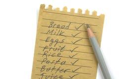 Lápis e lista de compra Foto de Stock Royalty Free