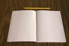 Lápis e livro Fotografia de Stock Royalty Free