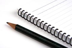 Lápis e livro de nota Foto de Stock