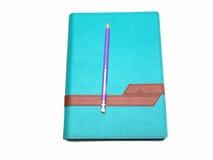 Lápis e livro de nota foto de stock royalty free