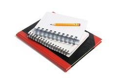 Lápis e livros de nota Fotografia de Stock Royalty Free