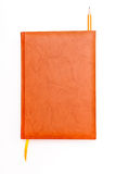Lápis e marcador do caderno de Brown isolados no branco Fotografia de Stock Royalty Free