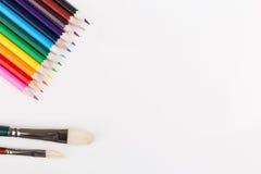 Lápis e pincéis coloridos Imagem de Stock Royalty Free