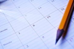 Lápis em um calendário Fotografia de Stock