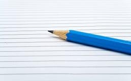 Lápis na folha de papel Foto de Stock