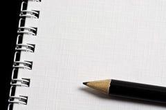 Lápis no bloco de notas Foto de Stock