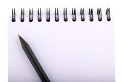 Lápis no caderno Fotografia de Stock Royalty Free