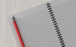 Lápis no caderno verificado no fundo de madeira Imagem de Stock