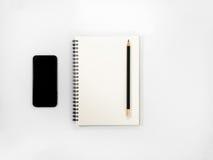 Lápis preto acima de um caderno aberto Imagem de Stock Royalty Free