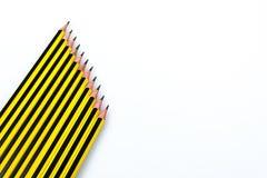 Lápis preto e amarelo das listras fotografia de stock