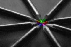 Lápis pretos, coloridos, no fundo preto Imagens de Stock