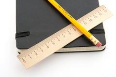 Lápis, régua e caderno Imagem de Stock