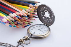 Lápis retros do relógio e da cor de bolso do estilo Foto de Stock Royalty Free