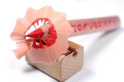Lápis vermelho brilhante com faca-apontador Imagem de Stock Royalty Free