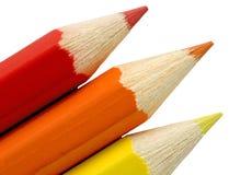 Lápis vermelhos, alaranjados e amarelos Imagem de Stock
