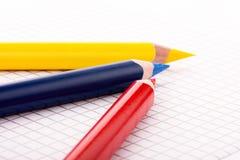 Lápiz coloreado tres en el papel ajustado Imagenes de archivo