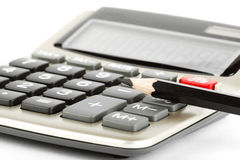 Lápiz con la calculadora Imágenes de archivo libres de regalías