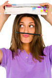 Lápiz de equilibrio del gir adolescente en su labio Fotos de archivo