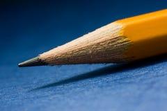 Lápiz del grafito en fondo azul Fotografía de archivo