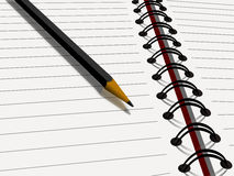 Lápiz en el cuaderno Foto de archivo libre de regalías
