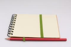 Lápiz en el cuaderno fotografía de archivo