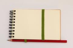Lápiz en el cuaderno imagen de archivo libre de regalías