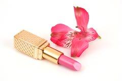 Lápiz labial y flor foto de archivo libre de regalías