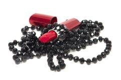 Lápiz labial y granos rojos Fotografía de archivo libre de regalías