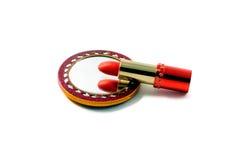 Lápiz labial y un espejo Imagen de archivo libre de regalías